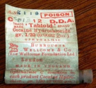 Packaging for cocaine hydrochloride pills for ophthalmic , manufactured by Burroughs, Wellcome & Co. Ltd, possibly 1920-1940.