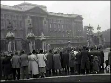 Crowds wait outside Buckingham Palace for news of the King's recovery © BBC