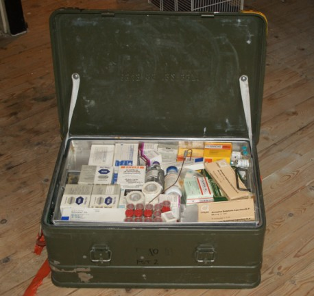 The first layer of the Triservice box contains various drugs and pieces of equipment to be used in an emergency