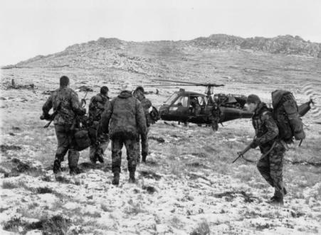 Wounded Scots Guards head to a Scout helicopter for evacuation, IWM (FKD 317)
