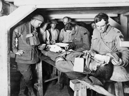 An Australian medical officer treats a wounded soldier at an Advanced Dressing Station in the Third Battle of Ypres, 1917, (C) IWM E (AUS) 714