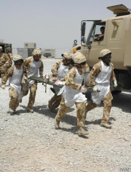 Transferring an injured child to the hospital in Camp Bastion, © IWM (12BDE-2007-015-046)