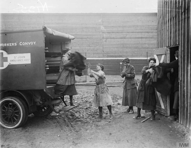 © IWM (Q 10705) First Aid Nursing Yeomanry (FANY) loading an ambulance with disinfected blankets at St Omer, 28 February 1918.