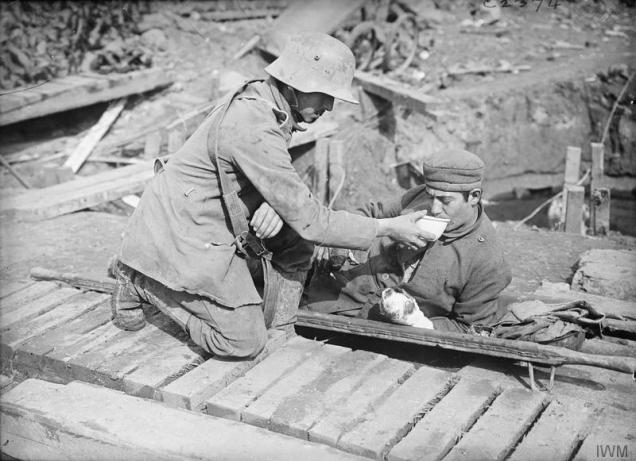 Q2858 a German prisoner attending a wounded comrade on a stretcher during the Battle of the Merin Road Ridge 20 Sept 1917